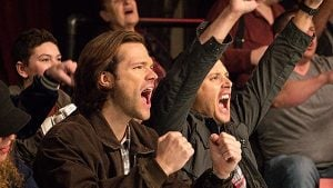 Sam and Dean enjoy a bit of wrasslin' before jumping on the case.