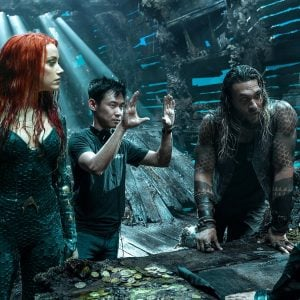 """Film Name: AQUAMAN<br /> Copyright: © 2018 WARNER BROS. ENTERTAINMENT INC.<br /> Photo Credit: Jasin Boland/ ™ &amp; © DC Comics<br /> Caption: (L-r) AMBER HEARD, director JAMES WAN, JASON MOMOA and WILLEM DAFOE on the set of Warner Bros. Pictures' action adventure """"AQUAMAN,"""" a Warner Bros. Pictures release."""