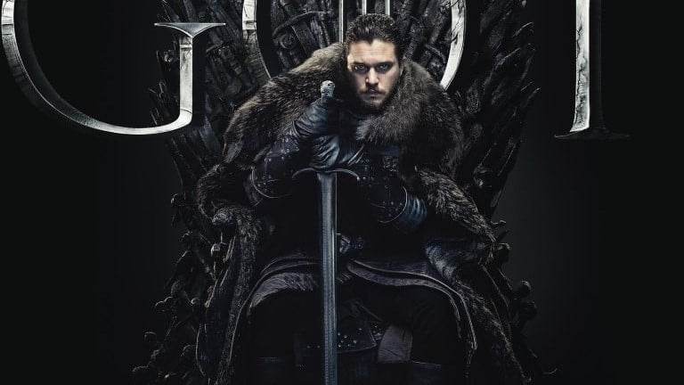 Kit Harington sitting on the Iron Throne