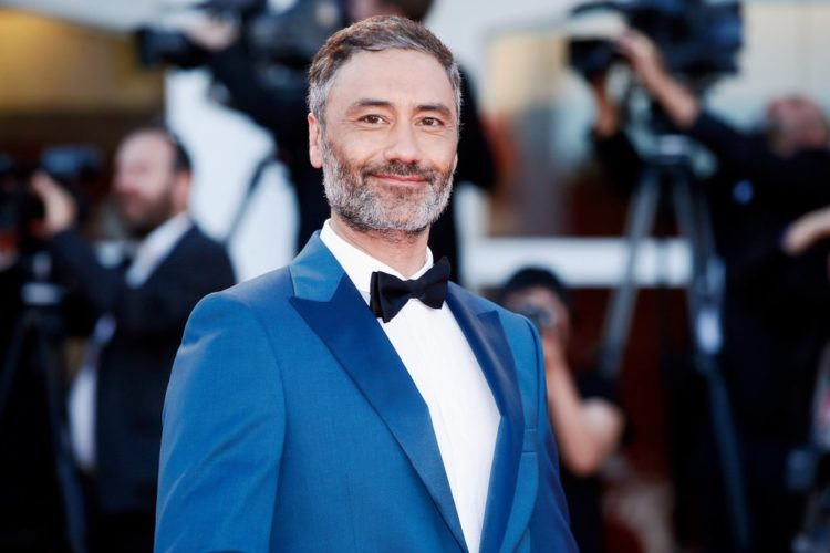 Taika Waititi in blue jacket