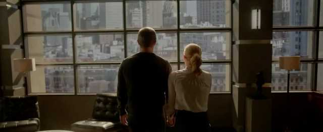 The backs of Oliver and Felicity as they look out their apartment window