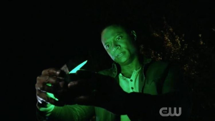 Green Lantern tease: John Diggle opens box with green light emitting from it.
